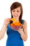 The woman likes eating chips Stock Photo