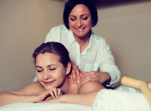 Woman likes procedure of massage Royalty Free Stock Photo