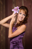 Woman in a lilac dress Stock Images