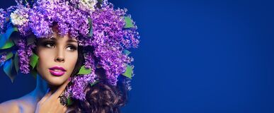 Free Woman Lilac Flower Wreath Hat, Beautiful Fashion Models With Purple Flowers In Hairstyle On Blue Royalty Free Stock Image - 183189286