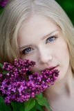 Woman with a lilac flowers. Stock Photo
