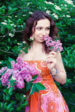 Woman with lilac flowers Royalty Free Stock Images