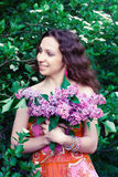 Woman with lilac flowers Royalty Free Stock Photography