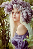Woman with Lilac flowers Stock Photo
