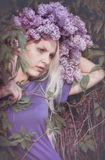 Woman with Lilac flowers Stock Image