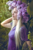 Woman with Lilac flowers Stock Photography
