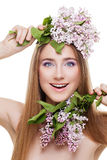 Woman with lilac Stock Photography