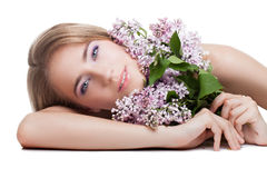 Woman with lilac Royalty Free Stock Images