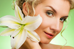 Woman with lily flower Stock Photos