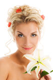 Woman with lily flower Royalty Free Stock Images