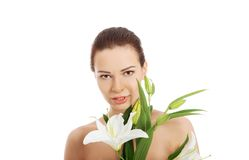 Woman with a lily flower Stock Image