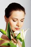 Woman with a lily flower Royalty Free Stock Photos
