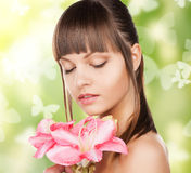 Woman with lily flower and butterflies Stock Photo