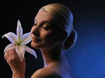 Woman with lily flower toned in blue Stock Photos