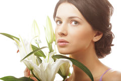 Woman with a lily flowers Stock Photos