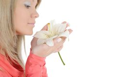 Woman with lily in her hand Royalty Free Stock Image