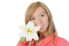Woman with lily in her hand Stock Image