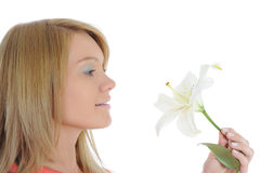 Woman with lily in her hand Royalty Free Stock Photos