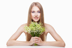 Woman with lily of the valley Royalty Free Stock Images