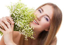 Woman with lily of the valley Stock Images
