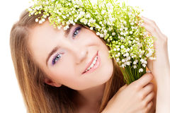 Woman with lily of the valley Royalty Free Stock Photo