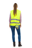 Woman In Lime Green Reflective Vest. Rear View. Stock Photo