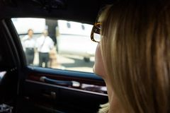 Woman In Limousine At Airport Terminal Stock Image