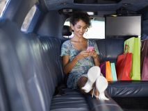 Woman in limousine after shopping Stock Photo