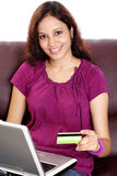 Woman on line shopping Stock Images