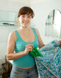 Woman with linen basket Stock Image