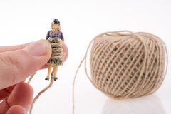 Woman beside a linen spool of thread Royalty Free Stock Images