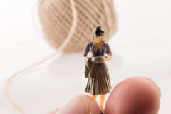 Woman beside a linen spool of thread Stock Photography