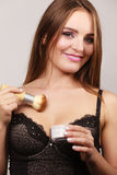 Woman in lingerie applying loose powder with brush Royalty Free Stock Photos