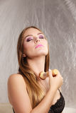 Woman in lingerie applying loose powder with brush Royalty Free Stock Photography
