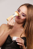 Woman in lingerie applying loose powder with brush Royalty Free Stock Image