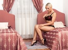 Woman in lingerie on bed Royalty Free Stock Photo