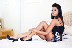 Woman in lingerie on bed Stock Photos