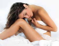 Woman in lingerie in bed Stock Photography