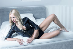 Woman in lingerie on bed Stock Photography