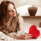 Woman in lingerie in bed. Valentines day love. Stock Images