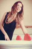 Woman in lingerie in bed. Valentines day love. Royalty Free Stock Photography