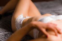 Woman and lingerie Stock Images