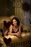 Woman in lingerie on the couch Royalty Free Stock Photos