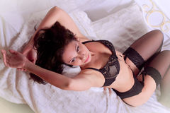 Woman in lingerie on the couch Royalty Free Stock Images