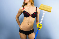 Woman in lingerie doing housework Stock Photo