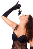 Woman in  lingerie eating grapes Stock Images