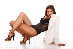 Woman in lingerie and fur coat Royalty Free Stock Photos