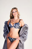 Woman in lingerie and fur coat. Royalty Free Stock Images