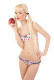 Woman in lingerie holding red apple Stock Photography