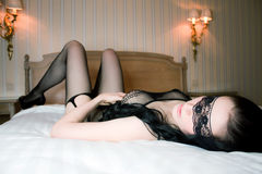 Woman in lingerie lying in bed Royalty Free Stock Photography